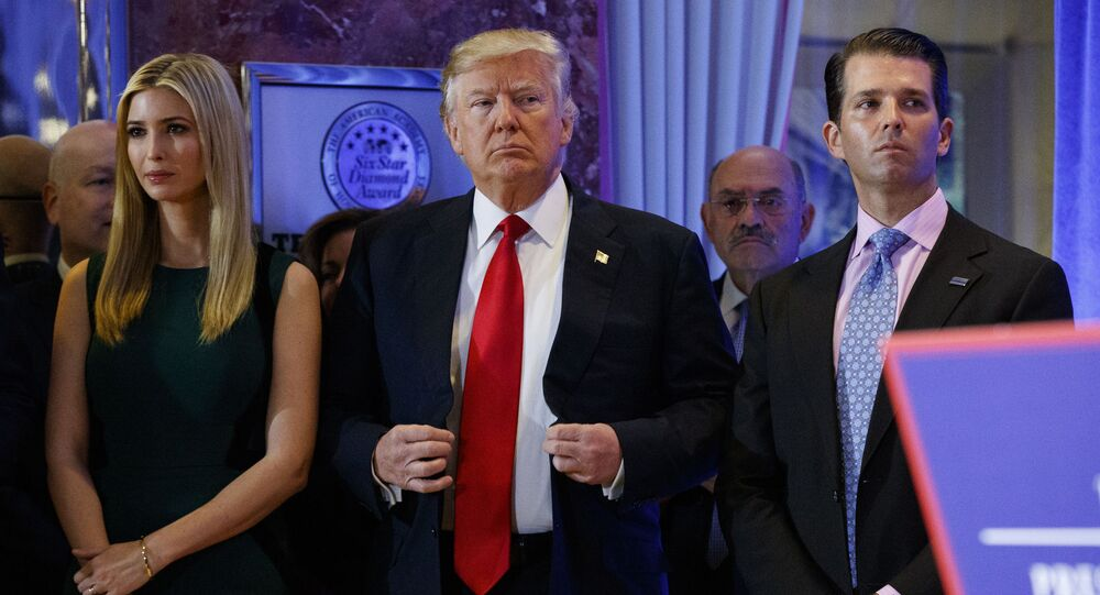 In this Jan. 11, 2017, photo, President-elect Donald Trump, center, stands next to Allen Weisselberg, second from left, Donald Trump Jr., right and Ivanka Trump, left, at a news conference in the lobby of Trump Tower in New York