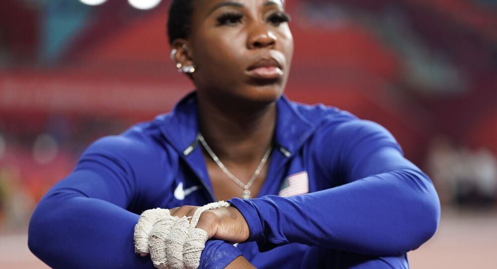 Gwen Berry, of the United States, waits for the women's hammer throw final to begin at the World Athletics Championships in Doha, Qatar, Saturday, Sept. 28, 2019