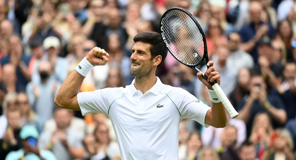 Tennis - Wimbledon - All England Lawn Tennis and Croquet Club, London, Britain - June 30, 2021 Serbia'a Novak Djokovic celebrate winning his first round match against South Africa's Kevin Anderson
