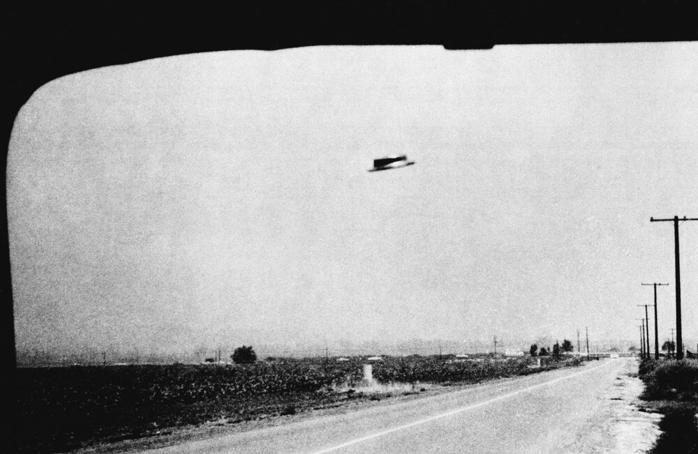 This is one of three photos of a supposed UFO taken by Rex Heflin, on 3 August 1965, near Santa Ana, Calif. Heflin served as an Orange County highway department investigator.
