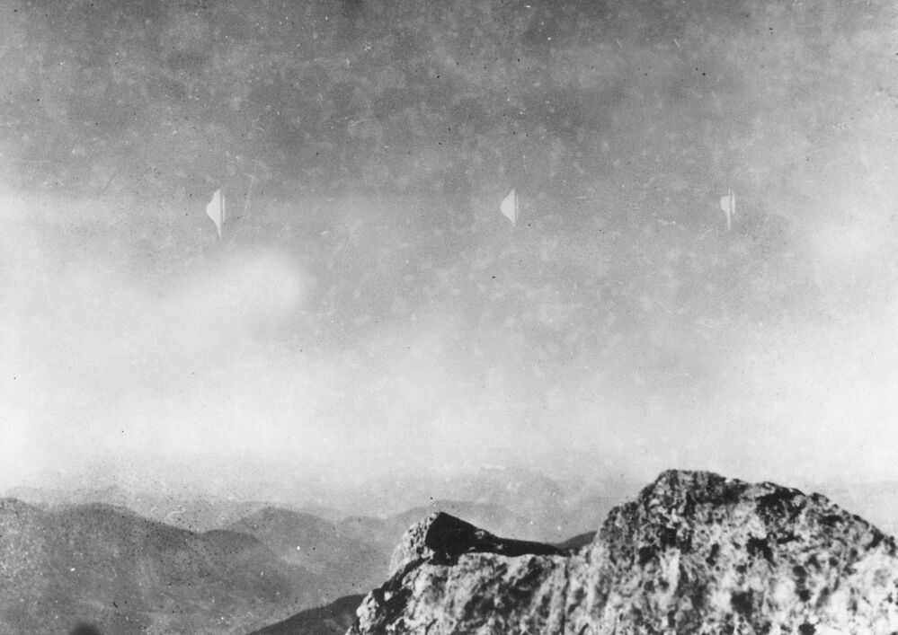 This photograph, reproduced from the quarterly UFO periodical Flying Saucers International in Los Angeles, shows silvery white flying objects photographed by Erich Kaiser while descending from Reichenstein mountain in Austria on 3 August 1954.