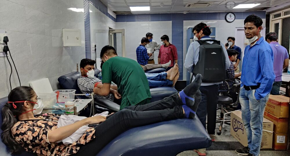 People donate blood at the blood donation camp organised by the resident doctors who work at the Dr Ram Manohar Lohia Hospital in New Delhi, India.