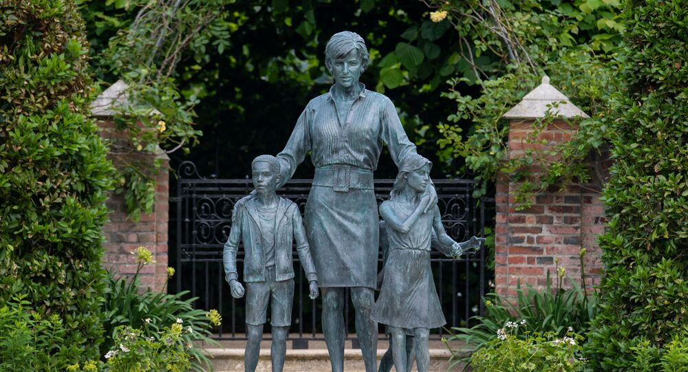 A statue of Britain's Princess Diana is pictured in the Sunken Garden at Kensington Palace, London, Britain July 1, 2021. Dominic Lipinski/Pool via REUTERS