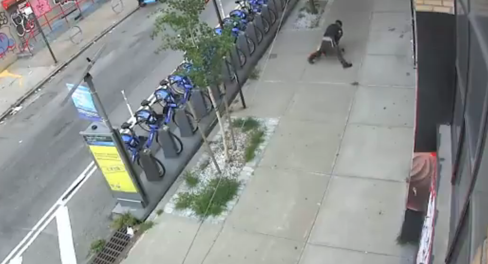 Screenshot from a NYPD video showing a man tackling a woman and groping her in Brooklyn, New York City
