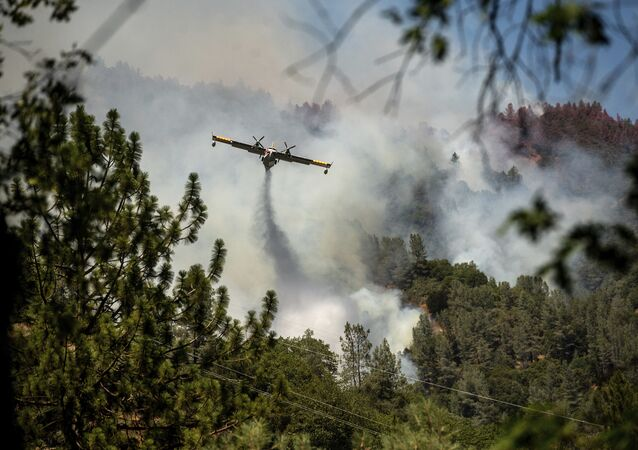 An air tanker drops fire retardant to battle the Salt Fire in Lakehead, Calif., on Thursday, July 1, 2021. Firefighters are battling multiple fires in the region following high temperatures and lightning strikes.