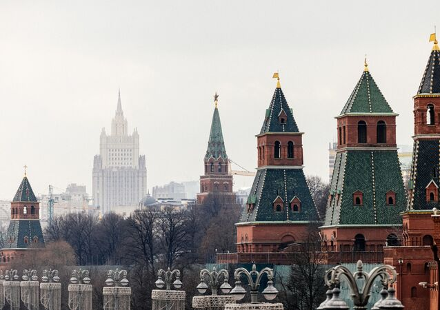This picture taken on March 18, 2021, shows the Kremlin towers in front of the Russian Foreign Ministry headquarters. - Russian President Vladimir Putin on March 18 mocked Joe Biden for calling him a killer -- saying it takes one to know one -- as ties between Moscow and Washington sunk to new lows. US President Biden's comments sparked the biggest crisis between Russia and the United States in years, with Moscow recalling ambassador and warning that ties were on the brink of outright collapse.