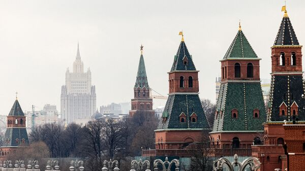 This picture taken on March 18, 2021, shows the Kremlin towers in front of the Russian Foreign Ministry headquarters. - Russian President Vladimir Putin on March 18 mocked Joe Biden for calling him a killer -- saying it takes one to know one -- as ties between Moscow and Washington sunk to new lows. US President Biden's comments sparked the biggest crisis between Russia and the United States in years, with Moscow recalling ambassador and warning that ties were on the brink of outright collapse.  - Sputnik International