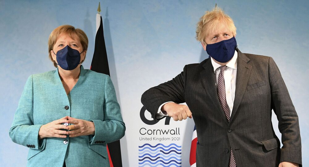 Britain's Prime Minister Boris Johnson, right, greets German Chancellor Angela Merkel ahead of a bilateral meeting during the G7 summit in Cornwall, England, 12 June 2021
