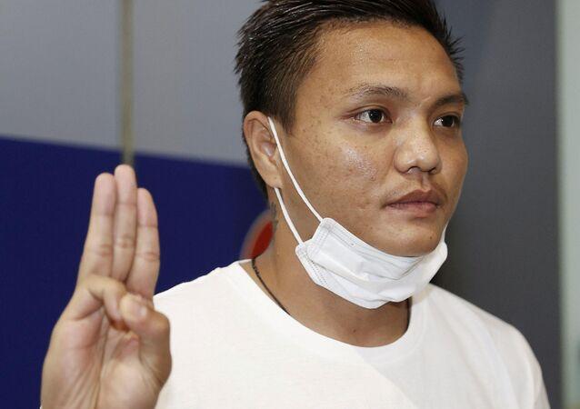 Pyae Lyan Aung, a Myanmar national football substitute goalkeeper, shows a three-finger salute after intending to seek refugee asylum at Kansai International Airport in Osaka Prefecture, Japan June 17, 2021