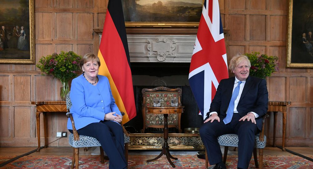 German Chancellor Angela Merkel poses with Britain's Prime Minister Boris Johnson before their bilateral meeting at Chequers, the official country residence of the Prime Minister, near Aylesbury, Buckinghamshire, Britain July 2, 2021.