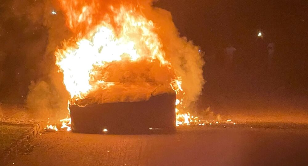 Tesla Inc's new Model S Plaid electric car is seen in flames in Pennsylvania, U.S., in this handout photo provided to Reuters on July 2, 2021.