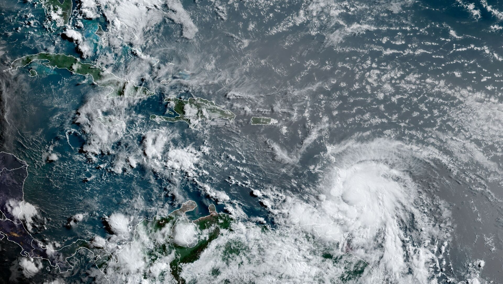 This satellite image provided by the National Oceanic and Atmospheric Administration shows Hurricane Elsa moving through the Caribbean, over Barbados, Tuesday, July 2, 2021, at 12:00 Z (8am a.m. ET). Elsa was expected to pass near the southern coast of Hispaniola on Saturday and to move near Jamaica and portions of eastern Cuba on Sunday. (NOAA/NESDIS/STAR GOES via AP) - Sputnik International, 1920, 02.07.2021