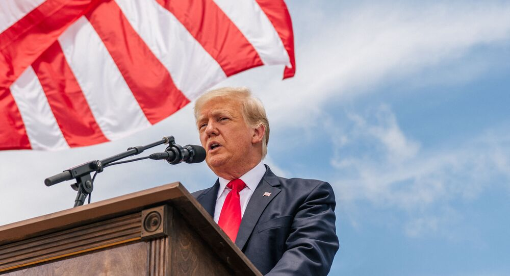 Former President Donald Trump speaks during a tour to an unfinished section of the border wall on June 30, 2021 in Pharr, Texas. Gov. Abbott has pledged to build a state-funded border wall between Texas and Mexico as a surge of mostly Central American immigrants crossing into the United States has challenged U.S. immigration agencies. So far in 2021, U.S. Border Patrol agents have apprehended more than 900,000 immigrants crossing into the United States on the southern border.