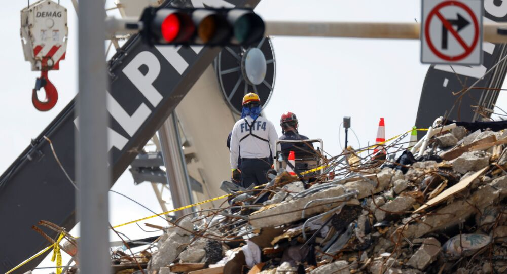 Rescue personnel continue the search and rescue operation for survivors at the site of a partially collapsed residential building in Surfside, Florida, U.S. July 2, 2021.