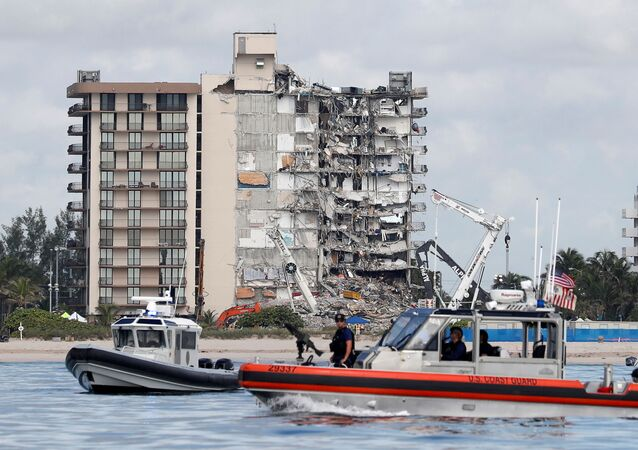 U.S. Coast Guard and Miami-Dade Police patrol as U.S. President Joe Biden visits the area while rescue efforts are halted at the site of a partially collapsed residential building in Surfside, near Miami Beach, Florida, U.S. July 1, 2021