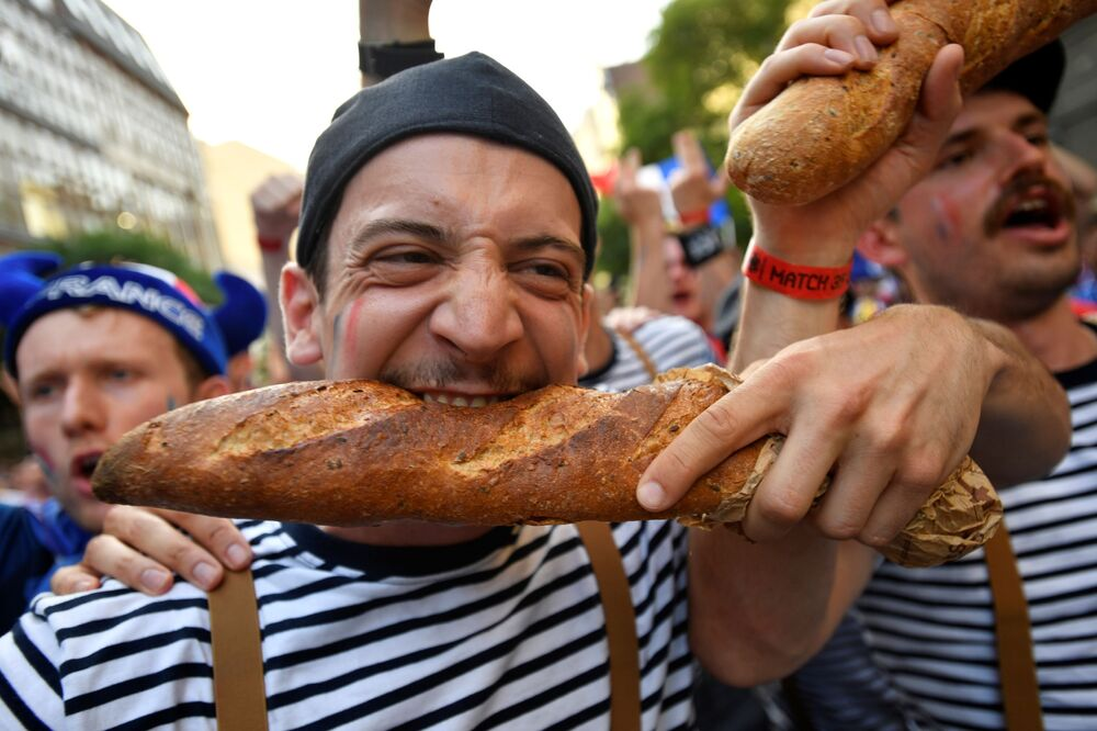 French fans gather before a match on 23 June 2021, taking a baguette with them, of course.