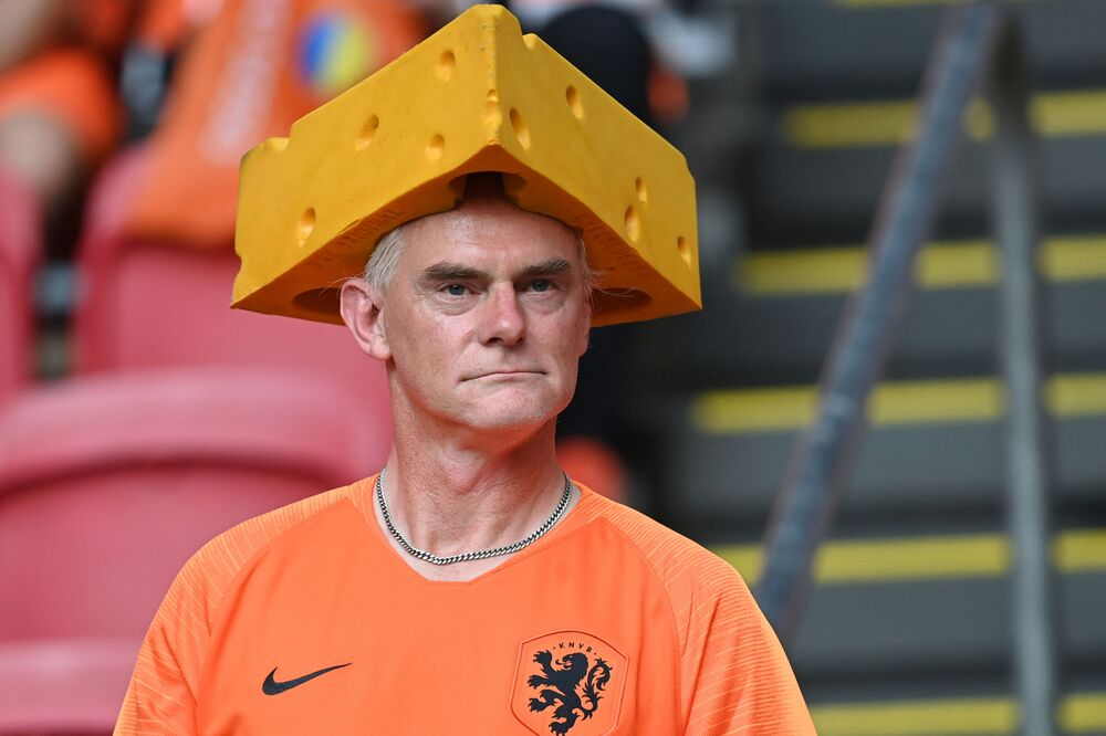 A Dutch fan at the Johan Cruyff Arena in Amsterdam wearing a cheese hat ahead of the UEFA EURO 2020 Group C football match between the Netherlands and Ukraine on 13 June 2021.