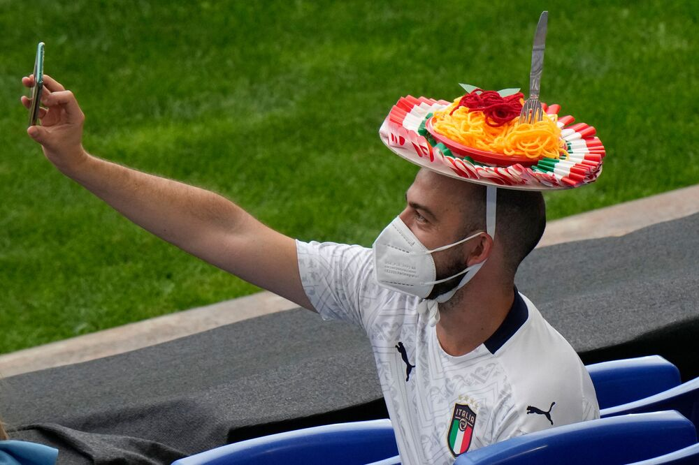 An Italy fan sporting an Spaghetti hat takes a selfie photo before the start of the UEFA EURO 2020 Group A football match between Turkey and Italy at Olympic Stadium in Rome on 11 June 2021.