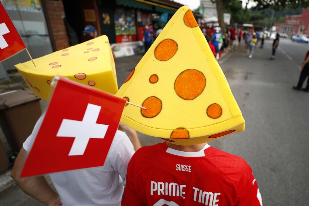 Switzerland fans wearing cheese hats outside the stadium before the match, 16 June 2021.