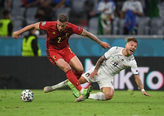 Belgium's Toby Alderweireld in action with Italy's Ciro Immobile