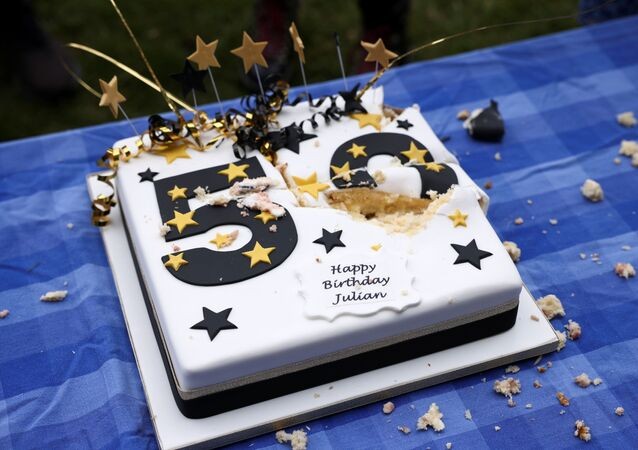 A cake is pictured during a picnic protest marking Wikileaks founder Julian Assange's 50th Birthday, on Parliament Square in London, Britain, 3 July 2021.