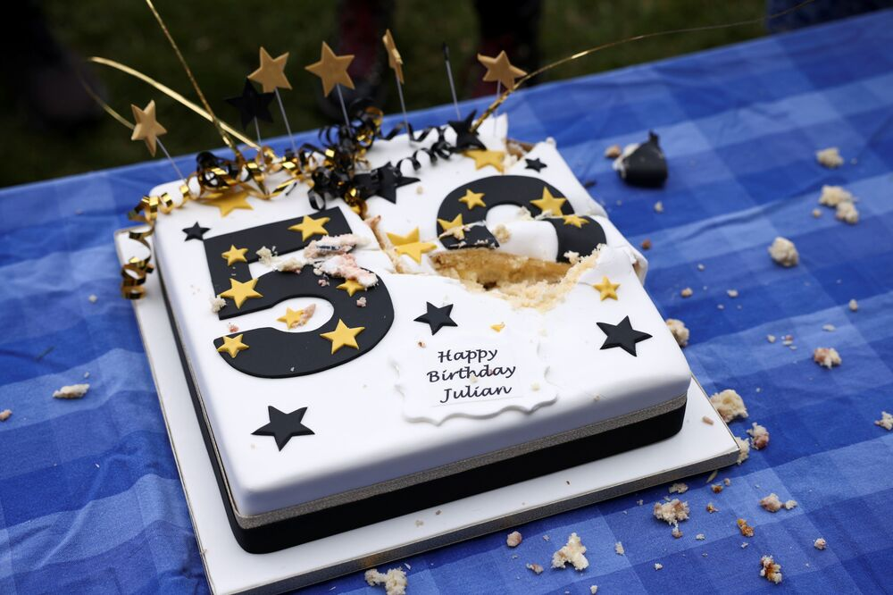 Assange faces up to 175 years in solitary confinement inside a top security American prison if convicted in the US.  Above: A cake for Assange.