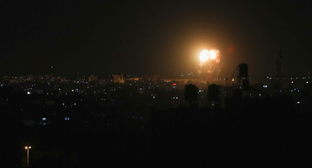 Smoke and flames are seen after an Israeli air strike in the northern Gaza Strip, June 17, 2021.
