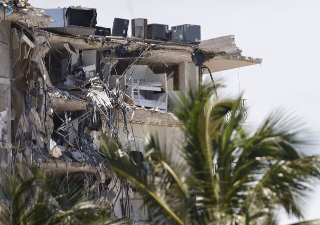 A general view of the partially collapsed 12-story Champlain Towers South condo building on July 03, 2021 in Surfside, Florida. Over one hundred people are being reported as missing as the search-and-rescue effort continues.