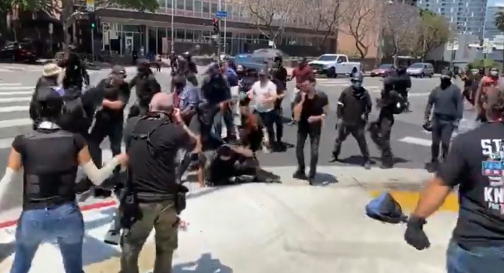 Screenshot from a video allegedly filmed in Los Angeles during clashes between protesters after an alleged transgender female exposed their genitals at a city spa