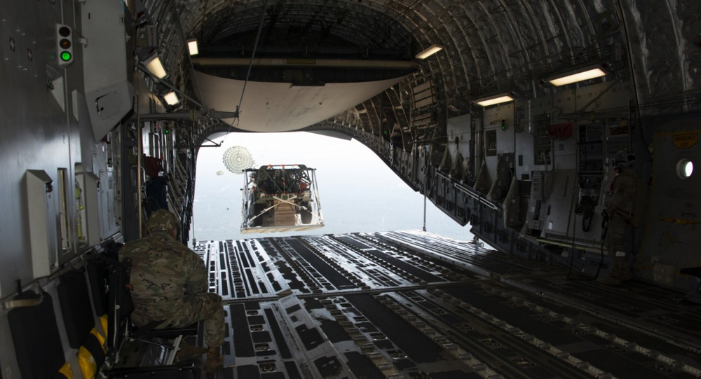 An Infantry Squad Vehicle (ISV) exits over the ramp of a U.S. Air Force C-17 aircraft during a low-velocity airdrop (LVAD) during operational testing at Fort Bragg, North Carolina.