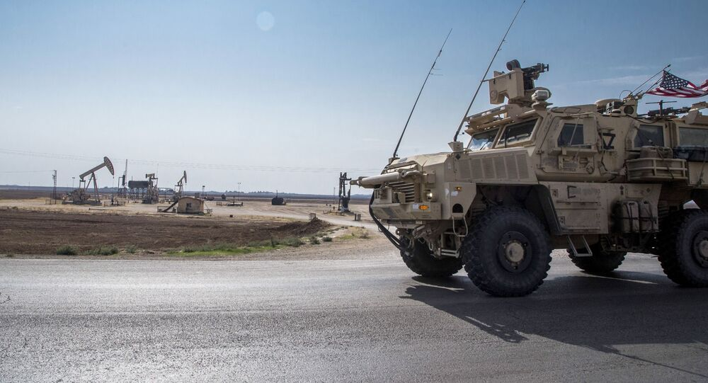 FILE - In this Oct. 28, 2019, file photo, U.S. forces patrol Syrian oil fields.