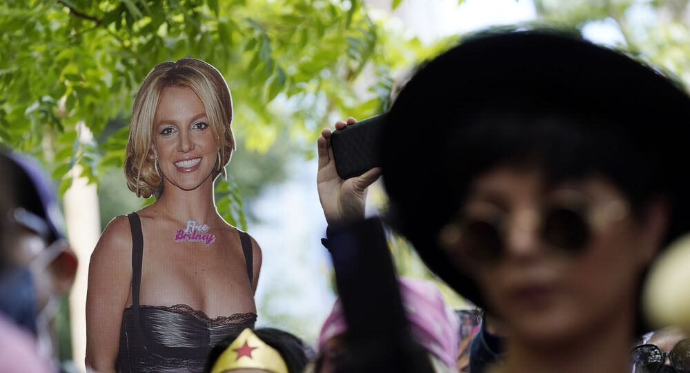 A cut-out of Britney Spears is seen in the crowd outside a court hearing concerning the pop singer's conservatorship at the Stanley Mosk Courthouse, Wednesday, June 23, 2021, in Los Angeles