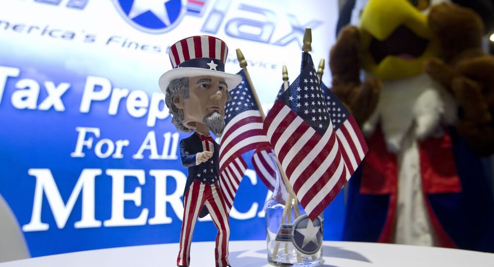 An Uncle Sam bubblehead decorates a booth during the Conservative Political Action Conference, CPAC 2019, in Oxon Hill, Md., Friday, March 1, 2019.