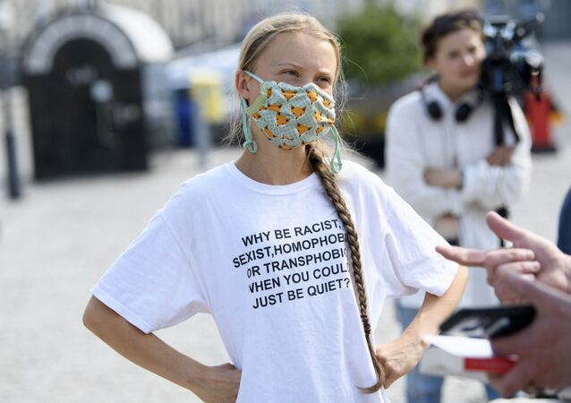 Swedish climate activist Greta Thunberg and other climate protesters gather for a protest against climate change in front of the Swedish parliament building in Stockholm, Sweden, on June 18, 2021.