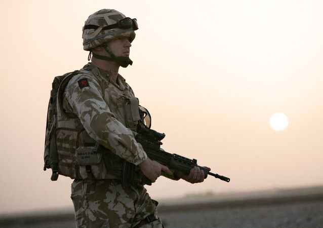 British soldier Captain Roger Walker from Air Operation Officer Battalion headquarters 1st Batalion The Royal Welsh together with US soldiers (not seen) from Bravo Company 1-508 Parachute Infantry Regiment 82nd Airborne Division search for Taliban insurgents in the village of Biabanak, Kandahar province,some 400 km south west of Kabul, 02 July 2007. Biabanak village is situated on the border line of Kandahar and Helmand Province