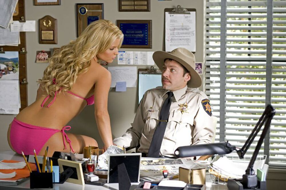 Jessica Simpson in The Dukes of Hazzard, 2005, wearing a pink bikini.