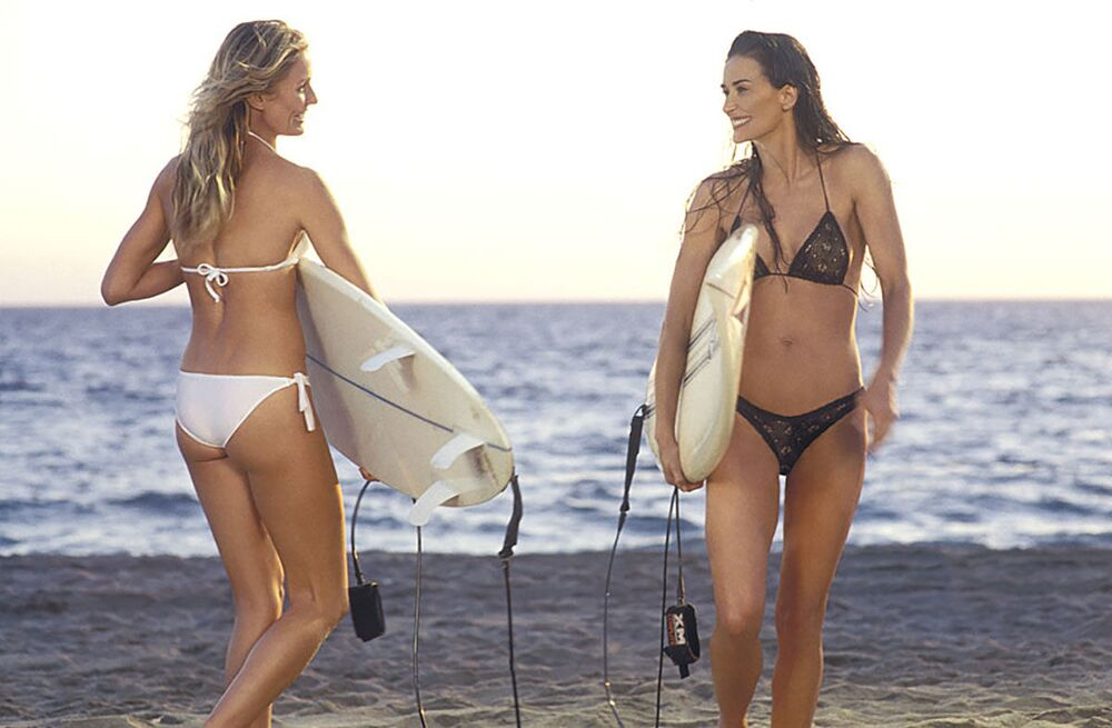 Black and white: Cameron Diaz and Demi Moore sporting bikinis in Charlie's Angels: Full Throttle, 2003.