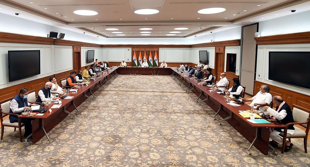 This photograph provided by the Prime Minister's Office shows members of various political parties with Indian Prime Minister Narendra Modi, center, and Home Minister Amit Shah, center right, in New Delhi, India, Thursday, June 24, 2021