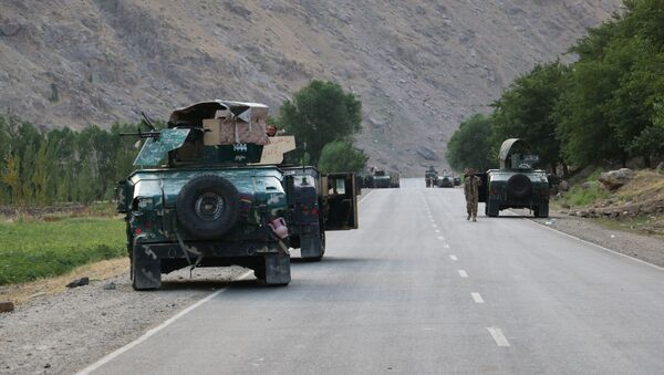Afghan soldiers pause on a road at the front line of fighting between Taliban and Security forces, near the city of Badakhshan, northern Afghanistan, Sunday, July. 4, 2021. - Sputnik International
