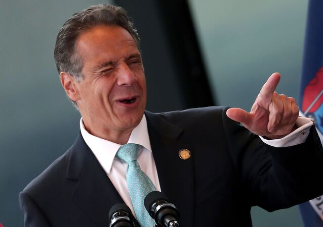 New York Governor Andrew Cuomo winks while speaking from the One World Trade Center Tower while making an announcement in New York City, New York, U.S., June 15, 2021.