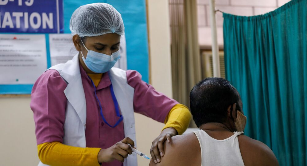 A man receives a Bharat Biotech's COVID-19 vaccine called COVAXIN, at a vaccination centre, in New Delhi, India, February 13, 2021.
