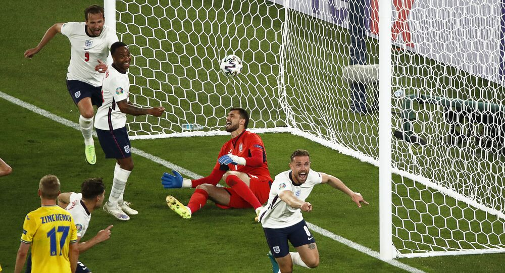 England midfielder Jordan Henderson (R) celebrates scoring the team's fourth goal during the UEFA EURO 2020 quarterfinal football match between Ukraine and England at the Olympic Stadium in Rome on 3 July 2021.