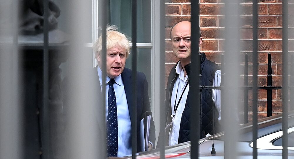 Britain's Prime Minister Boris Johnson (L) and his special advisor Dominic Cummings leave from the rear of Downing Street in central London on September 3, 2019, before heading to the Houses of Parliament
