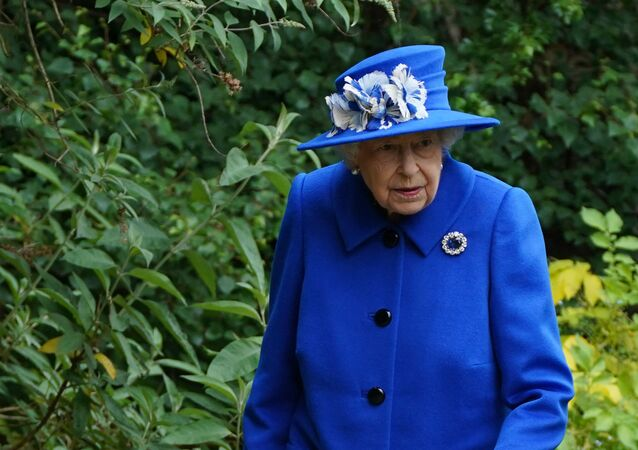 Britain's Queen Elizabeth II gestures during a visit to The Children's Wood Project in Glasgow on June 30, 2021