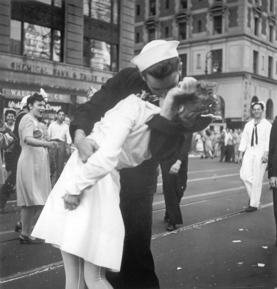 In this photo provided by the U.S. Navy, a sailor and a nurse kiss passionately in Manhattan's Times Square, as New York City celebrates the end of World War II, on 14 August 1945.