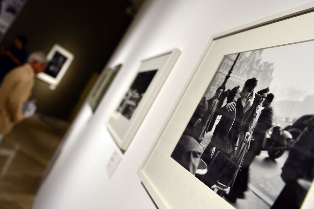 A visitor looks at pictures by French photographer Robert Doisneau during the Paris en Liberte exhibition held at the Palazzo delle Esposizioni in Rome on 28 September 2012.