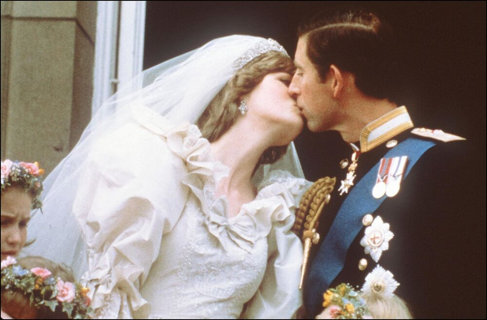 Charles, Prince of Wales, kisses his bride, Lady Diana, on the balcony of Buckingham Palace when they appeared before a huge crowd, on 29 July 1981, after their wedding in St Paul's Cathedral.
