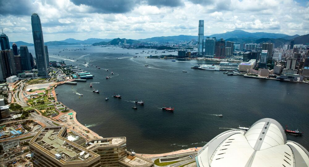 Fishing boats sail through Victoria harbour in Hong Kong on July 1, 2019