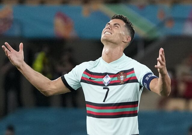 Soccer Football - Euro 2020 - Round of 16 - Belgium v Portugal - La Cartuja Stadium, Seville, Spain - June 27, 2021  Portugal's Cristiano Ronaldo reacts after the match