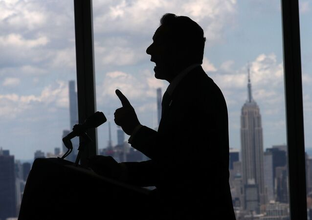 New York Governor Andrew Cuomo speaks with the skyline of Manhattan behind him from the One World Trade Center Tower while making an announcement in New York City, New York, U.S., June 15, 2021.